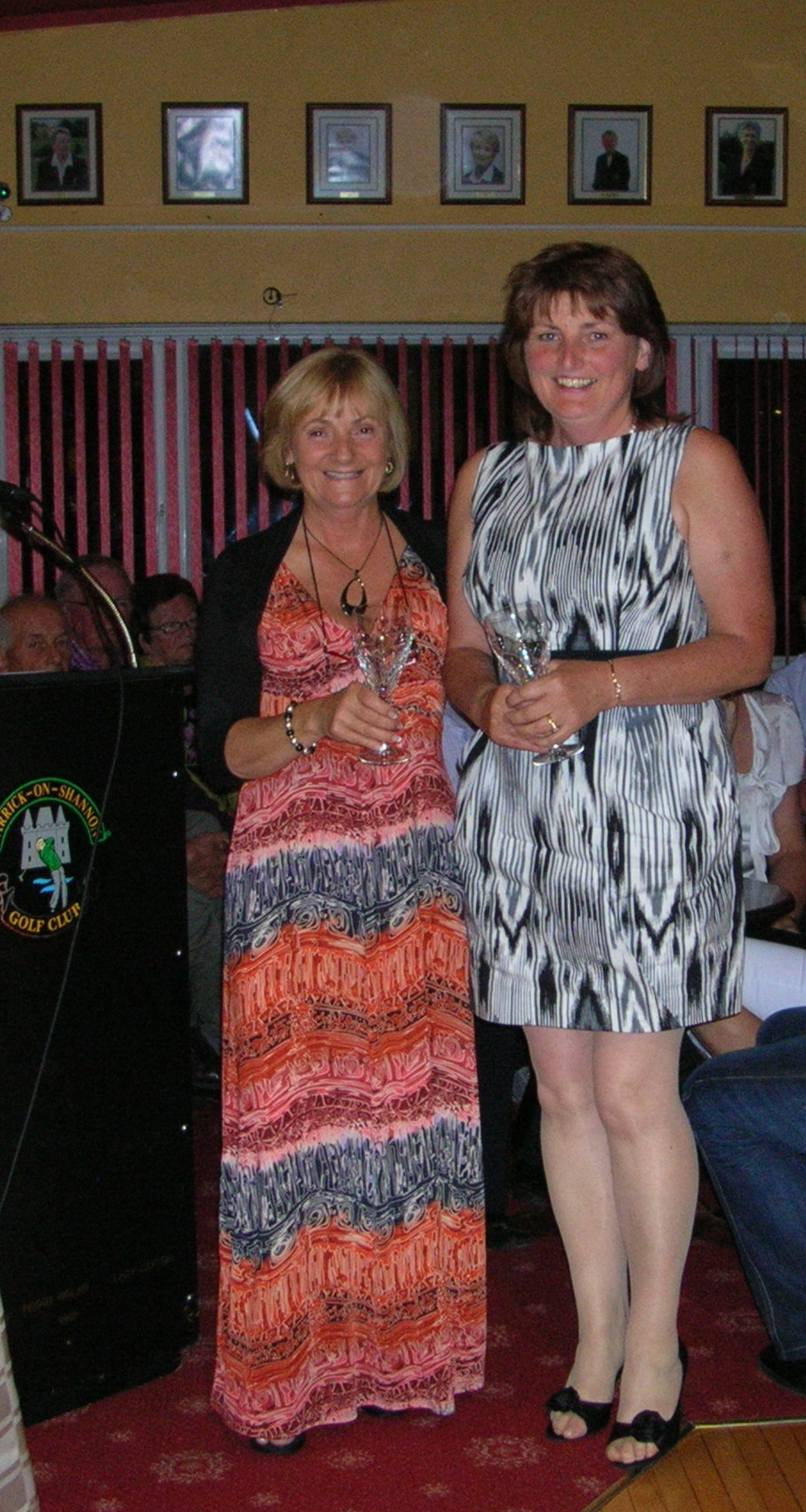 Dolores Mulvey is presented with Cat 20-29 Prize by Lady Captain Mary King on Captains Prize Day 2012