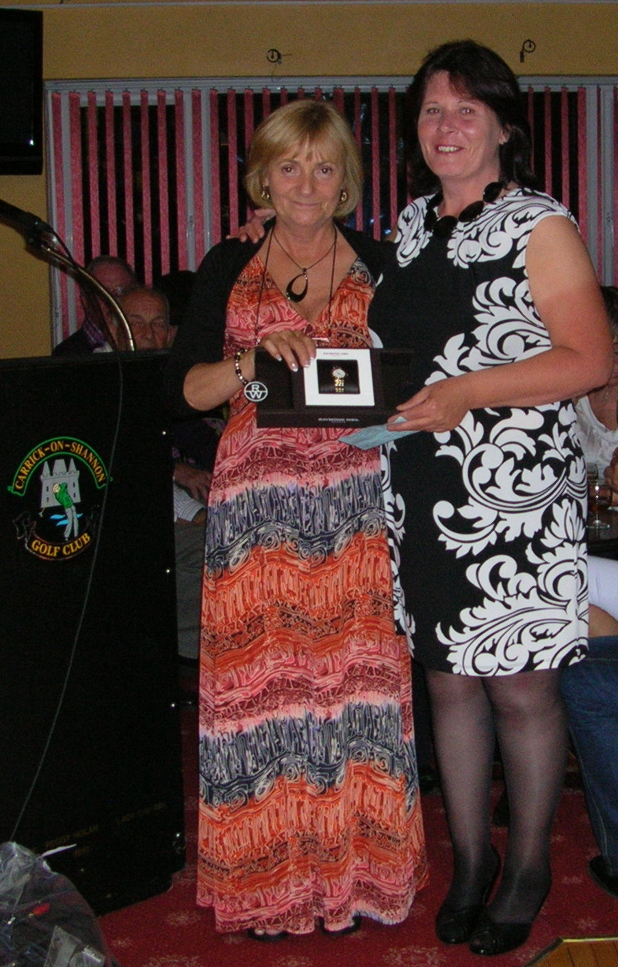 Lady Captain Mary King presents Lady Captains Prize 2012 to Brenda Kelly