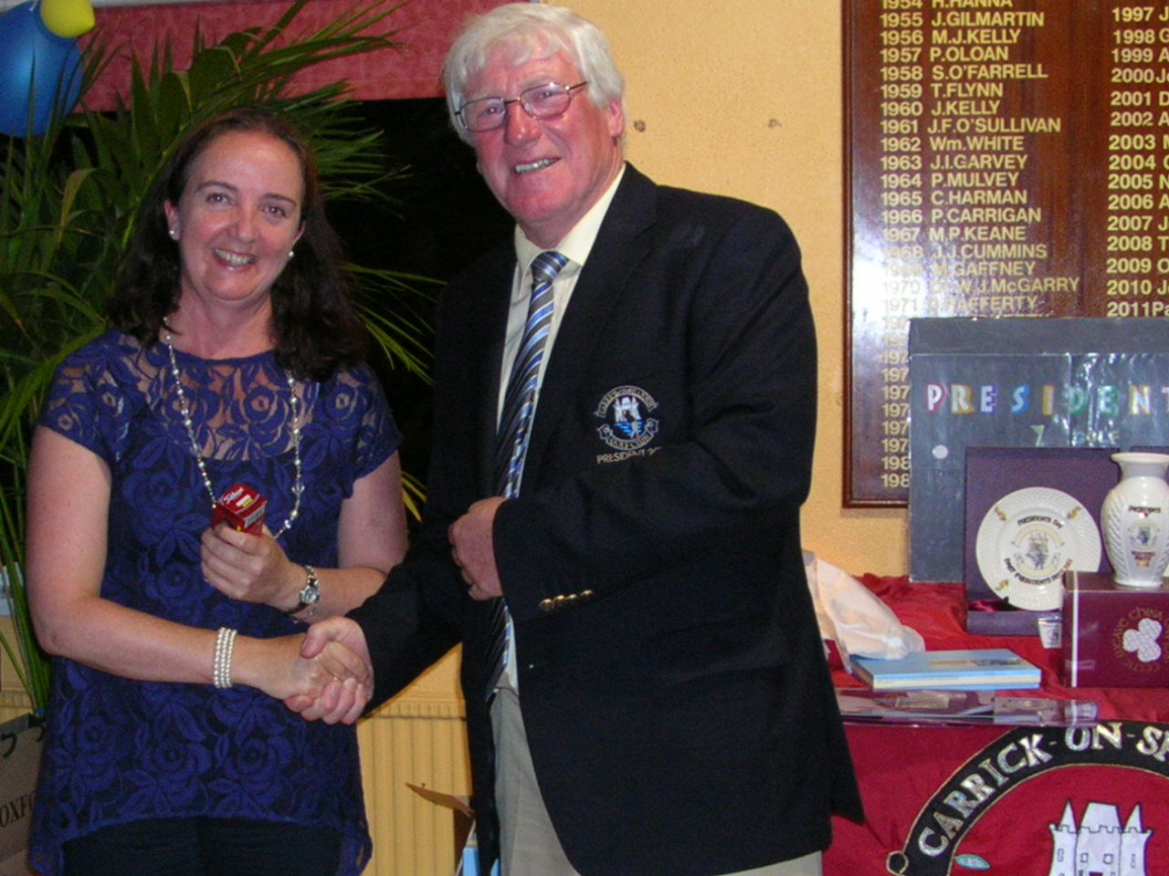 Hilary Collins presented with Birdie Prize by Club President PJ Sharkey