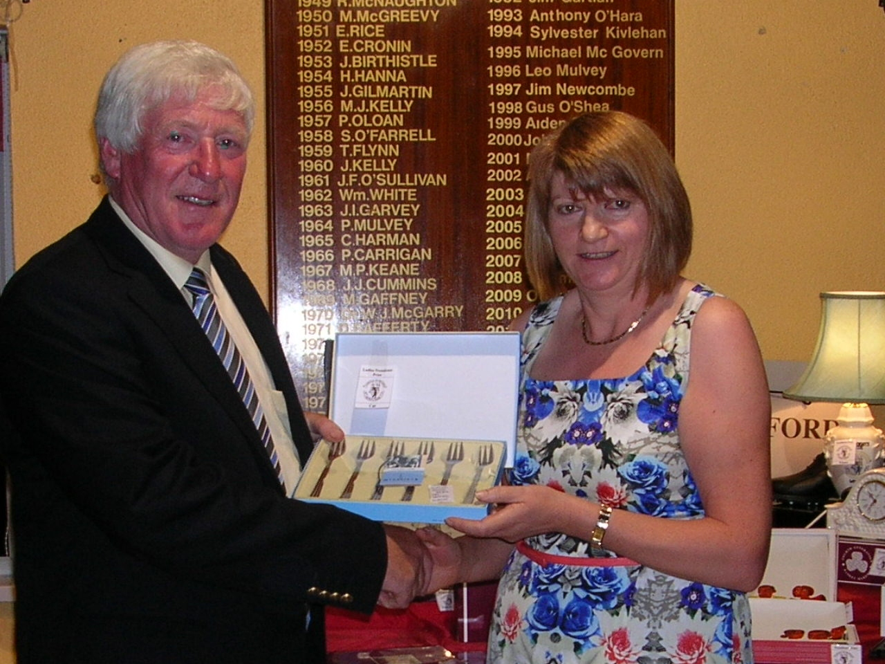 Mary Molloy presented with Cat 30-36 by President PJ Sharkey