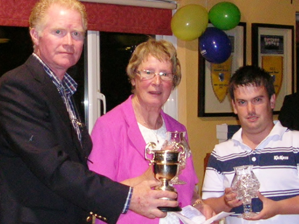 Captain Jim King presents The Rice Ardcarne Cup to Brigid Mannion & Niall Sweeney
