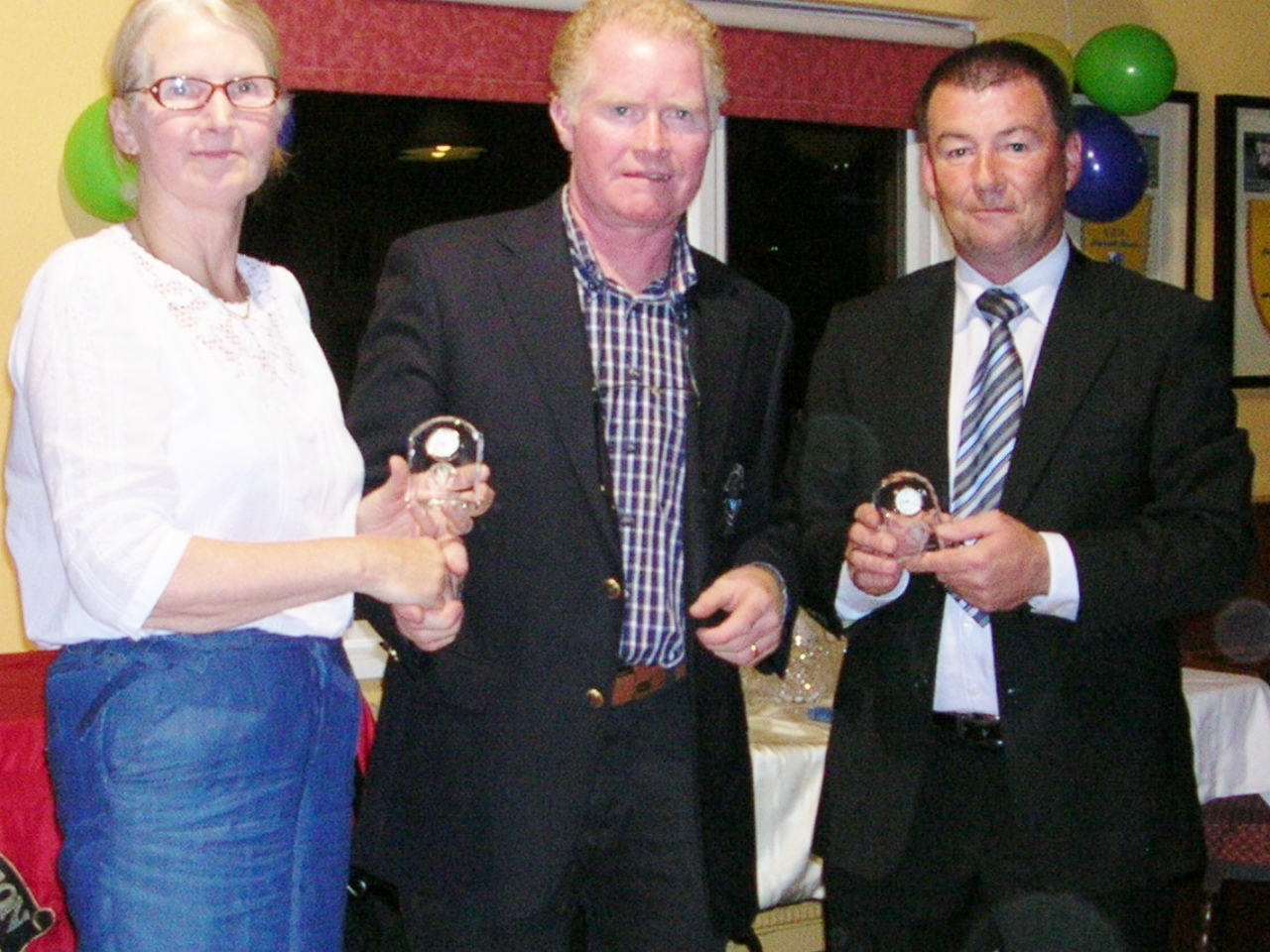 Esther Feely and Matt Farrell are presented with Third Prize by Captain Jim King in Ardcarne Rice Cup