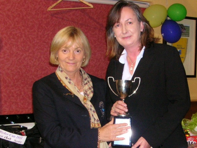 The Garvey Cup 2012 is presented by Lady Captain Mary King to Ann Dolan.