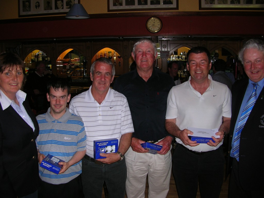 Captain Ollie Curran and Dolores Mulvey present Third Prize in June Bank Holiday Classic to Niall Sweeney, Seamus Sweeney, Johnny Martin, Matt Farrell
