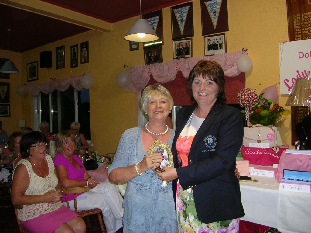Molly Daly is presented with Winner Front 9 by Lady Captain Dolores Mulvey