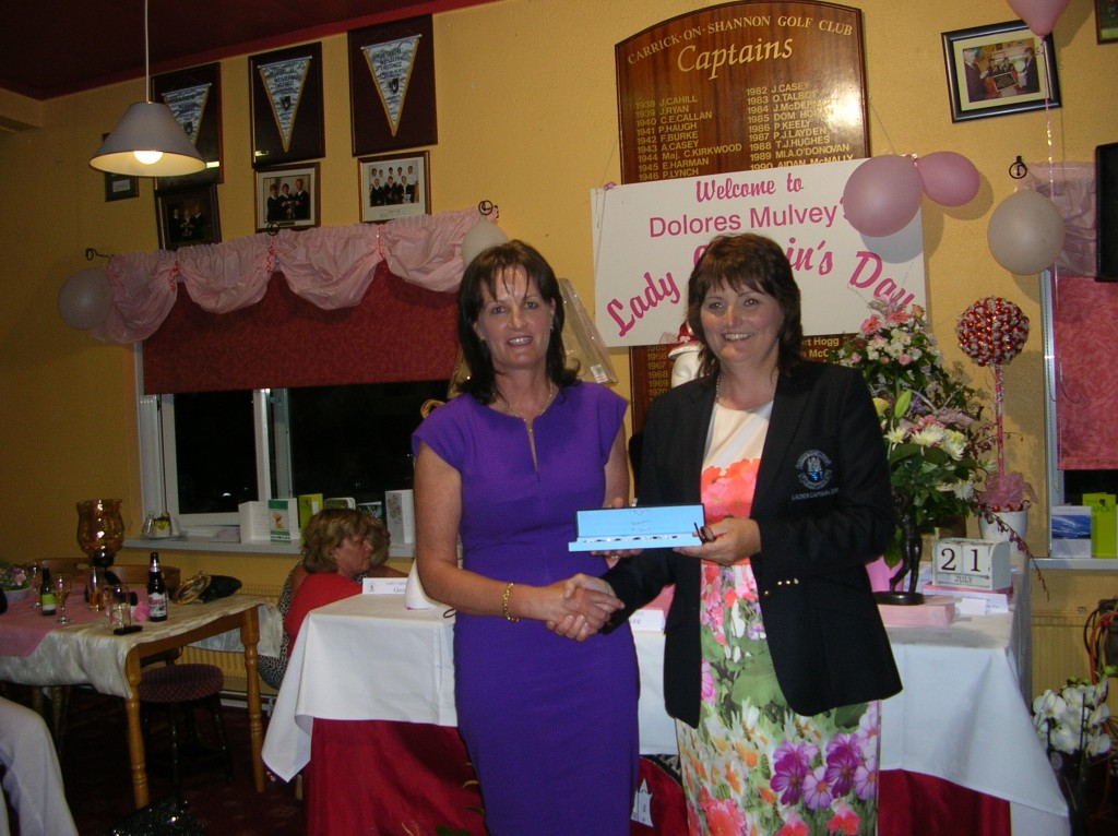 Eta King pictured receiving Second Prize on Lady Captains Day from Lady Captain Dolores Mulvey