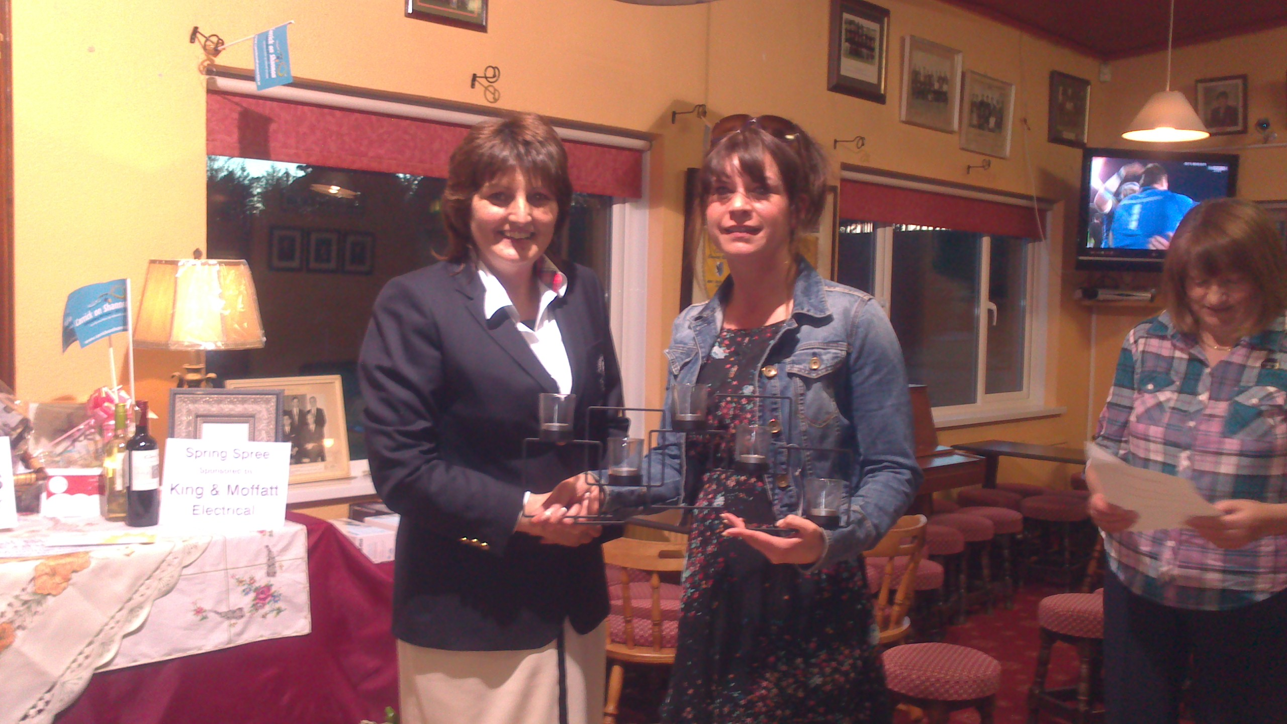 Maureen Egan presents First Prize in the Crumbs Stableford to Lady Captain Dolores Mulvey