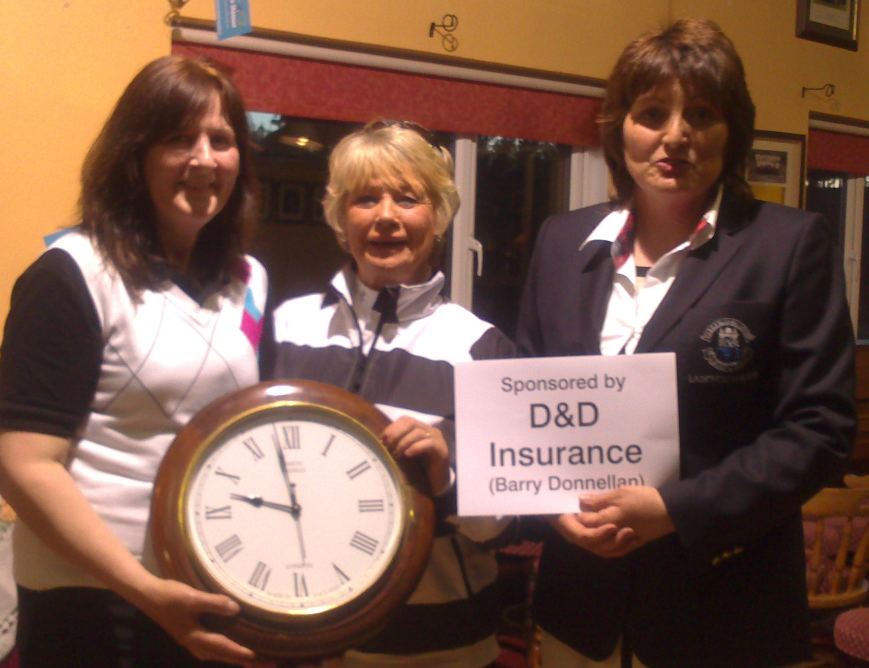 Lady Captain Dolores Mulvey and Molly Daly present Phil Emmett with Second Prize in D&D Insurance Stableford.