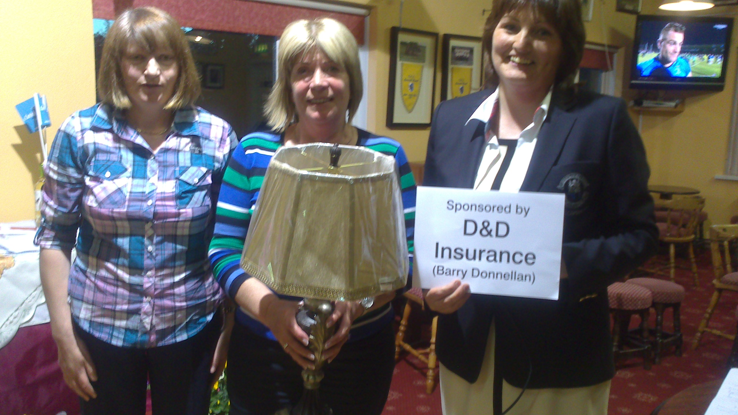 Kathleen Loftus pictured been presented with First Prize in D&D Insurance Stableford by Lady Captain Dolores Mulvey and Vice Captain Mary Molloy