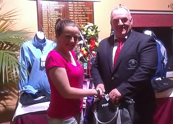Junior Golfer Eimear Gallagher pictured receiving Second Prize from Club President Mickey Daly