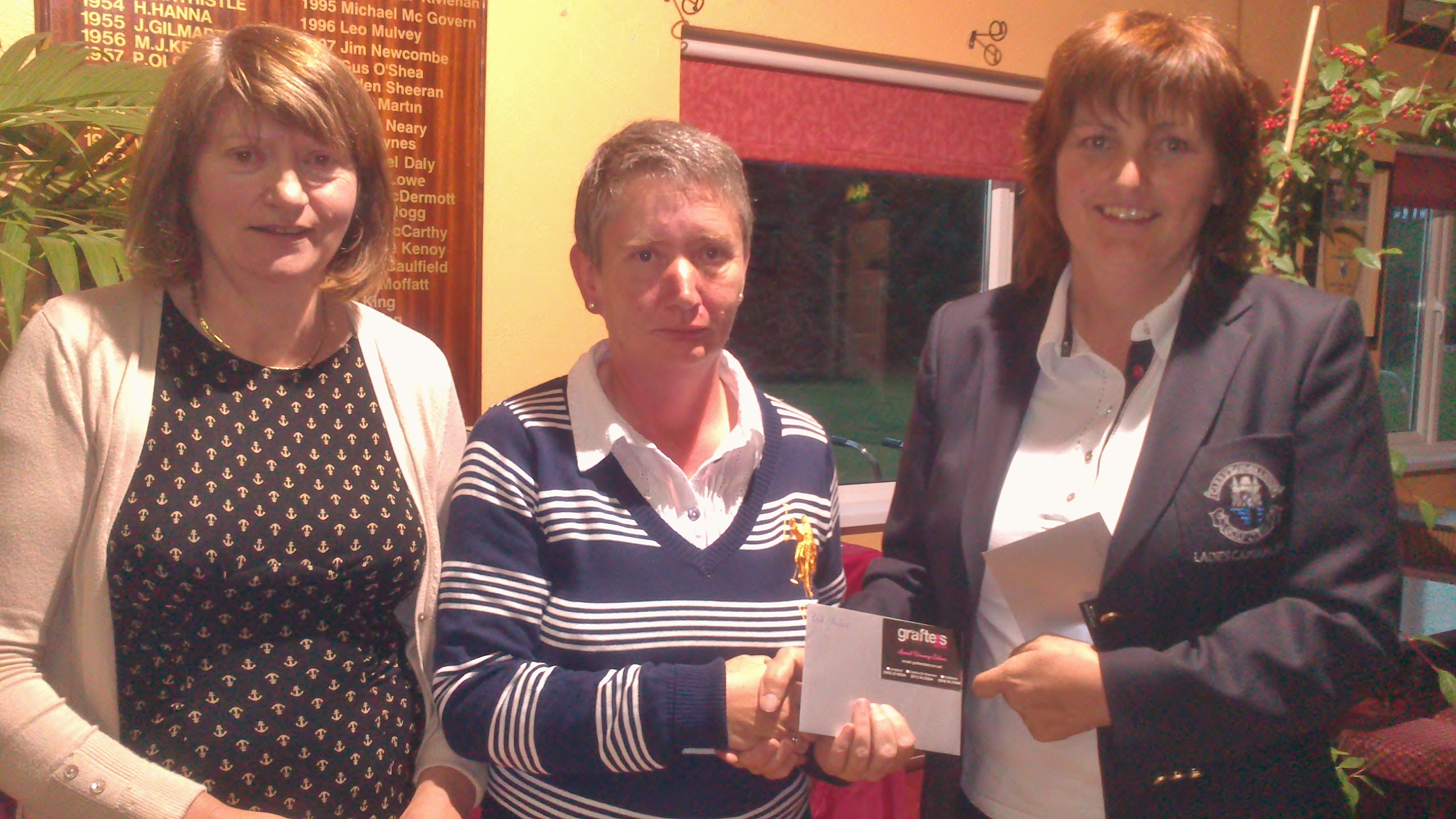Attracta O'Connor pictured receiving Second Prize in Grafters Hair Salon Stableford from Lady Captain Dolores Mulvey and Vice Captain Mary Molloy