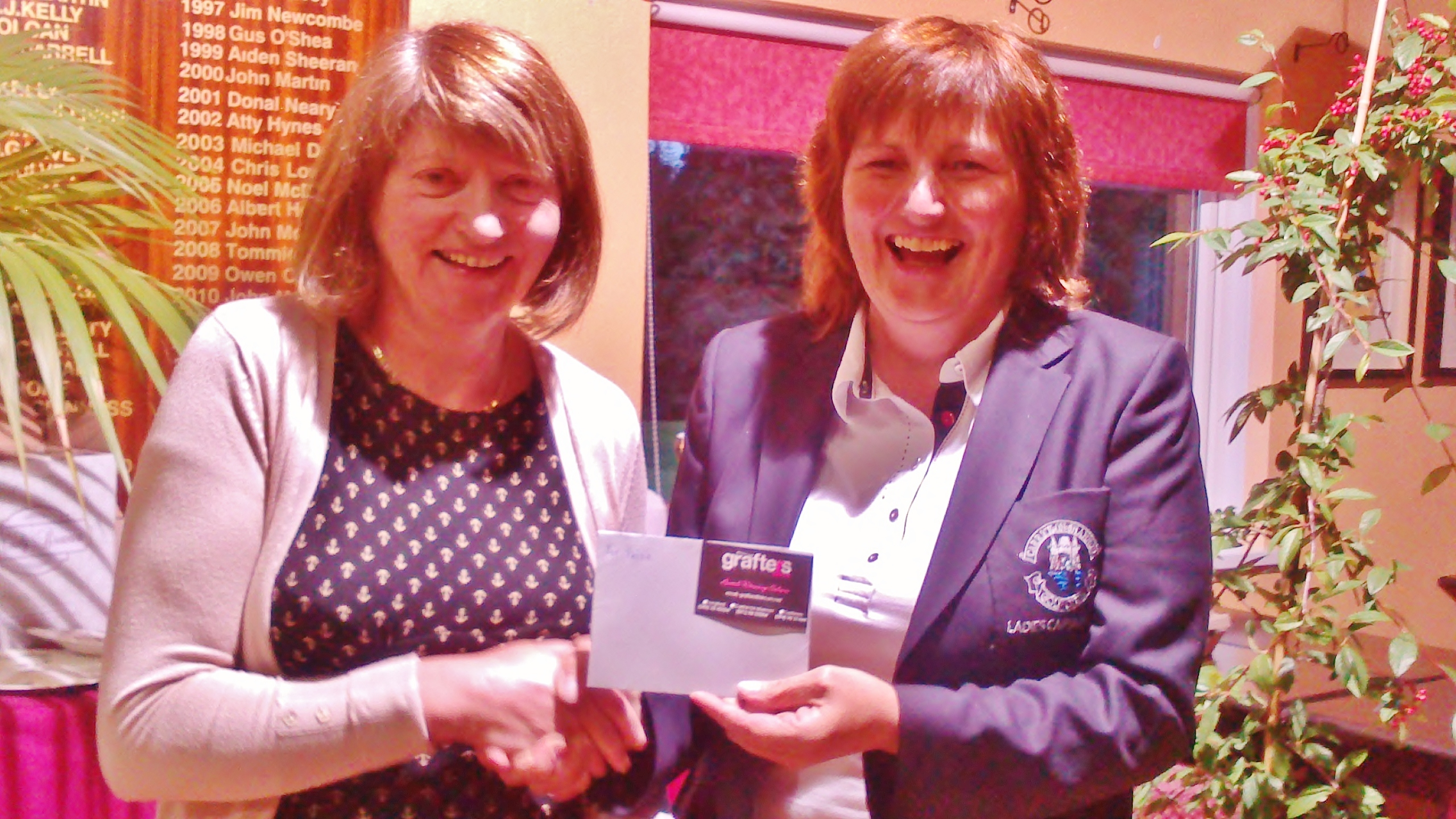 Mary Molloy pictured receiving First  Prize in Grafters Hair Salon Stableford from Lady Captain Dolores Mulvey.
