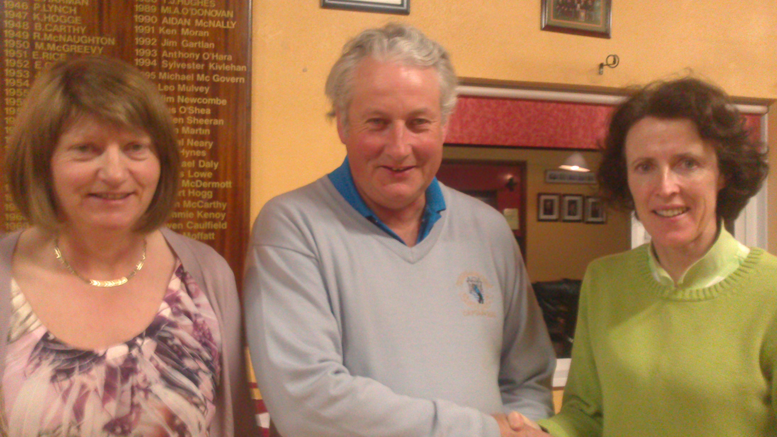 Vice Captain Mary Molloy and Captain Oliver Curran present Ger Farry with Second Prize  in The Arigna Fuels Stableford.