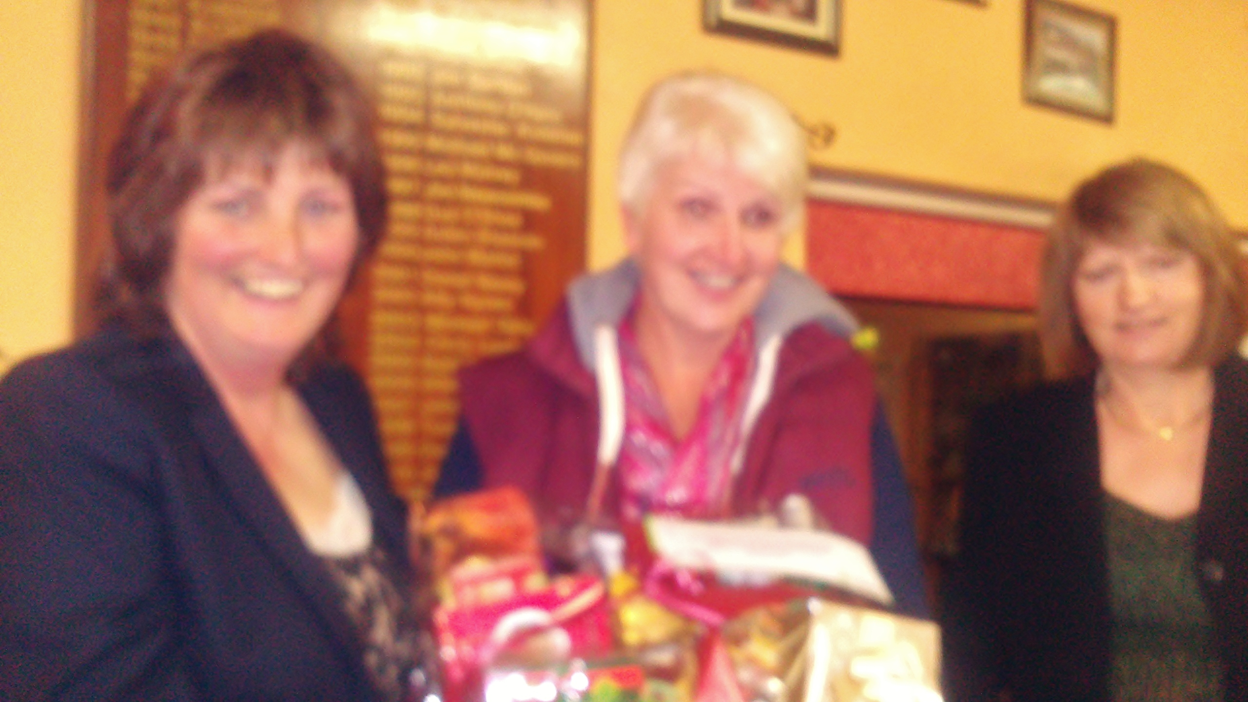 Lady Captain Dolores Mulvey and Vice Captain Mary Molloy present Second Prize in the Luneys Gala Stroke to Liz McAvoy