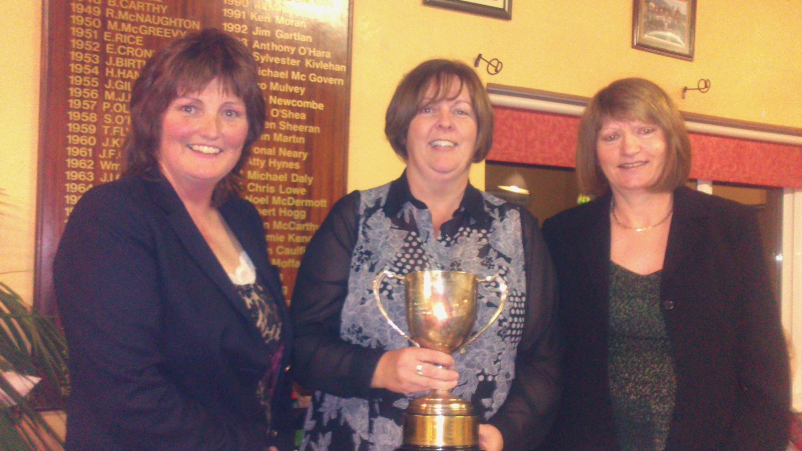 Captain Dolores Mulvey and Vice Captain Mary Molloy present Tracey Beirne with The 2013 Garvey Cup.