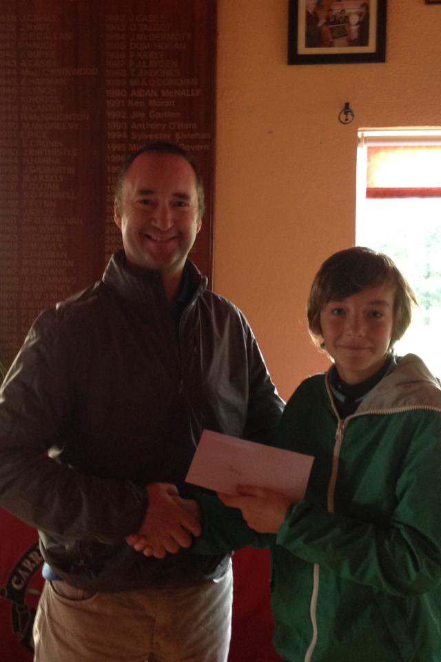 Hugo Brady Winner of the Cottage Junior Category is presented with his prize by Junior Conveyor Eamonn McGirl.