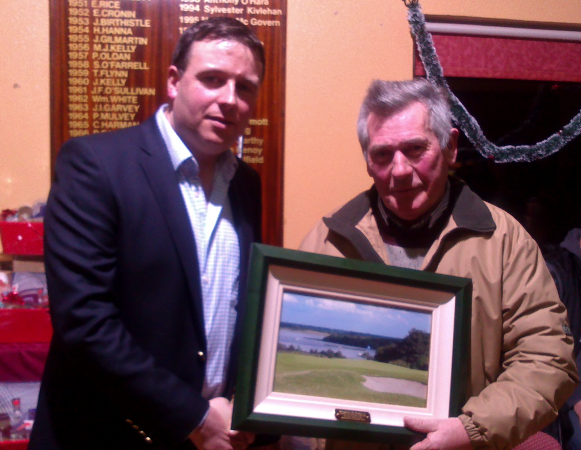 Captain Sean Bohan makes a presentation to Sean Lynch on his retirement after 30 years.