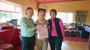 Mary O'Rourke is presented with winner back 9 in Alliance Captain's Day by Captains Marie Leyden and Ann Cox