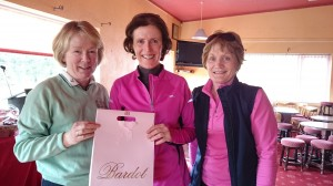 Ger Farry is presented with Winter Alliance Front 9  Prize on Captains Day by captains Marie Leyden and Ann Cox.