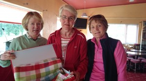 Anna Sheerin is presented with First Prize in Winter Alliance Captain's  Day by Captains Marie Leyden and Ann Cox