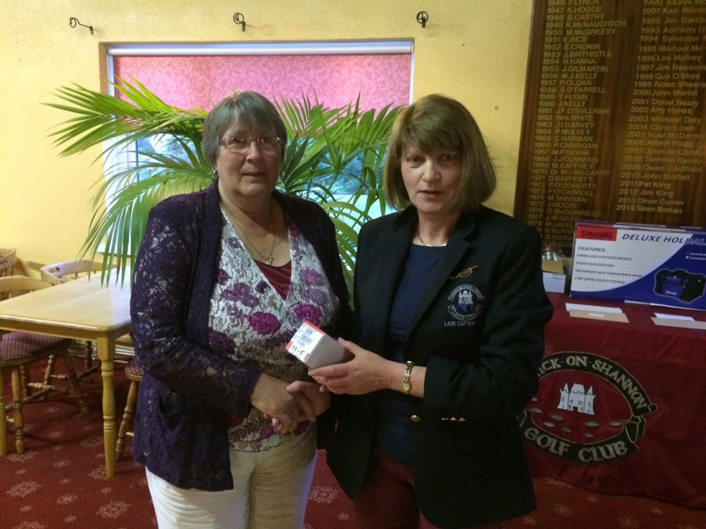 Lady Captain Mary Molloy presents Ladies First Prize in June Bank Holiday Classic to Sheila Carney(pictured)and Dolores Mulvey.
