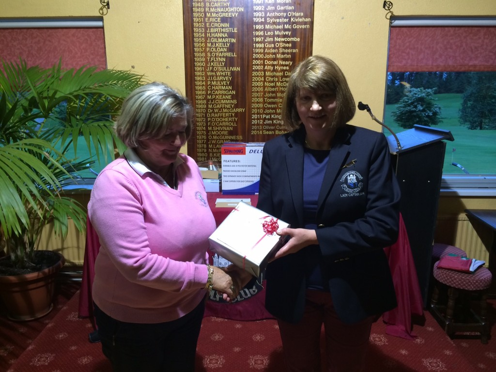Ann Campbell is presented with Winner Ladies Land on the Green, by Lady Captain Mary Molloy.