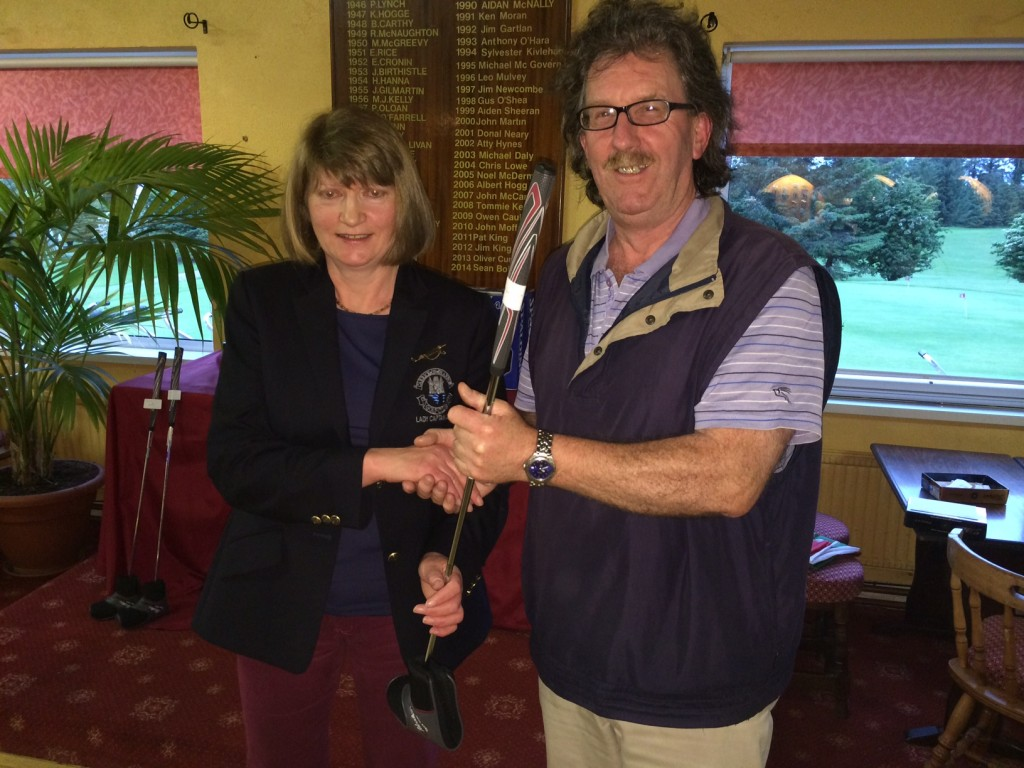 Martin Talbot is presented with Nearest The Pin in June Bank Holiday Classic by Lady Captain Mary Molloy