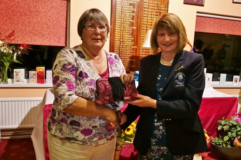 Lady Captain Mary Molloy presents Third Prize on Lady Captain's Day to Sheila Carney.