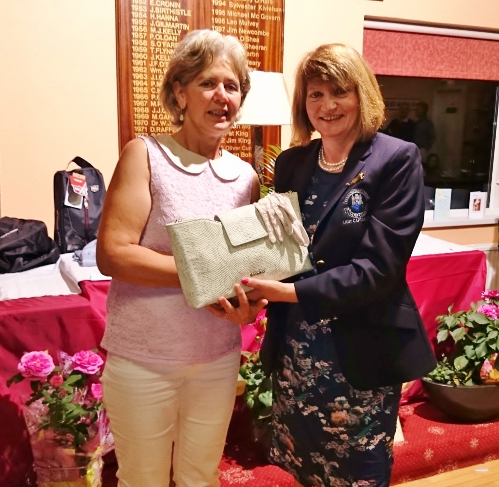 Phil McWeeney is presented with Gross Prize on Lady Captains Day by Captain  Mary Molloy.