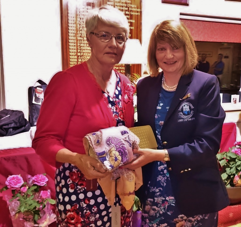 Lady Captains Day Second Prizewinner Anna Sheerin is presented with her prize by Lady Captain Mary Molloy.