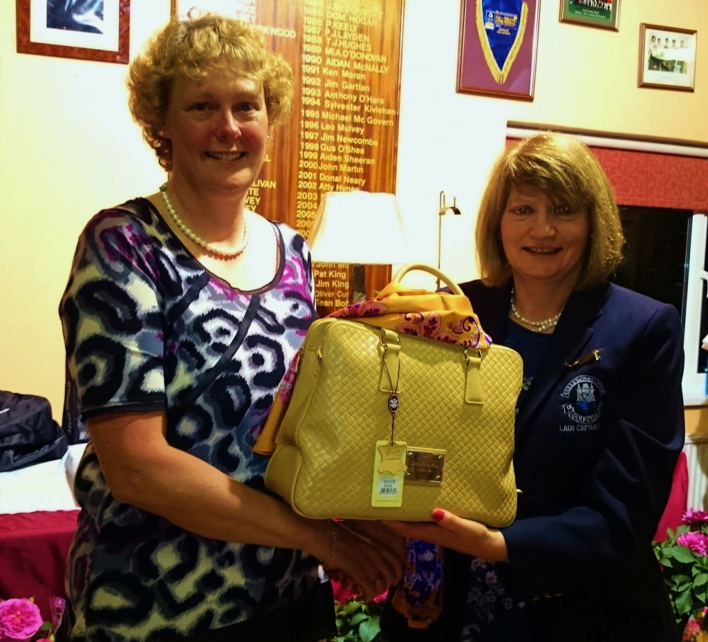 Lady Captain Mary Molloy presents Ann Keenan with Lady Captains Prize 2014.