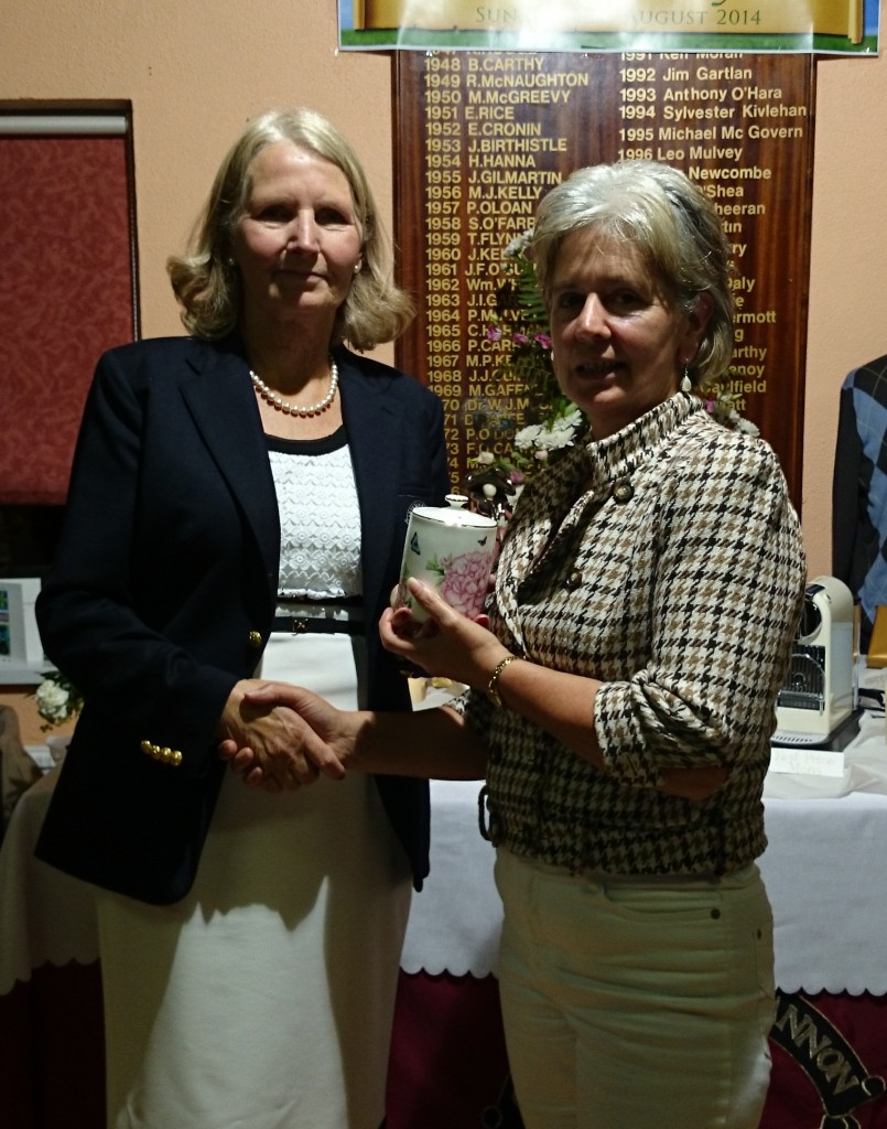 Phil McWeeney pictured receiving Third Prize on Presidents Day from Club President Esther Feely