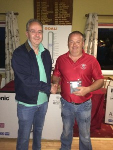 7th prizewinner in McGarry Trophy Kevin Ward receives his prize from David McGarry
