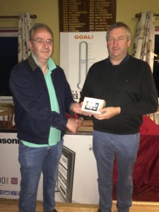 The third Sunday player to pick up a prize with 69 B9 Michael Keville receiving his prize from David McGarry