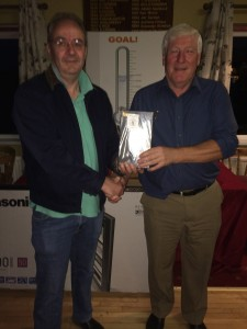 Clubhouse leader all day Saturday PJ Sharkey finished 3rd with 67 receives his prize from David McGarry