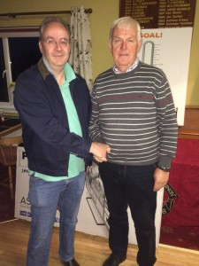 Runner Up in McGarry Trophy with a 65 shot on Sun morning in heavy rain Albert Hogg accepts his prize from David McGarry