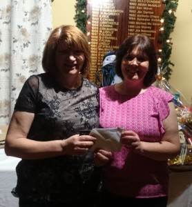 Competition Secretary Brenda Kelly makes a special presentation to Mary Molloy to mark her fantastic Hole In One on November 22nd.