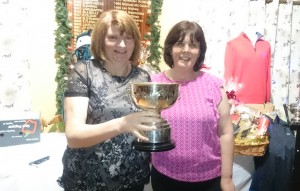 Mary Molloy is presented with the 2015 Lidl Lynch Cup by Competition Secretary Brenda Kelly.